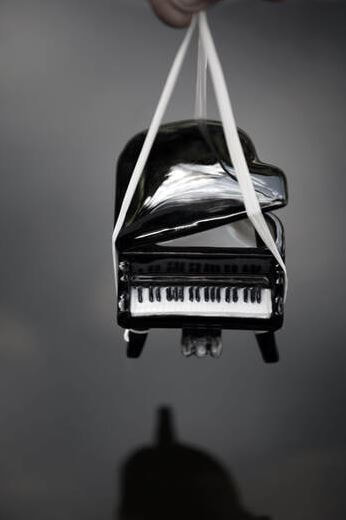 piano being hoisted in air for moving